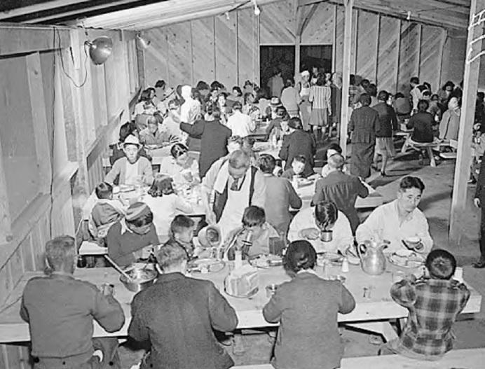 Internees eating at Manzanar War Relocation Camp