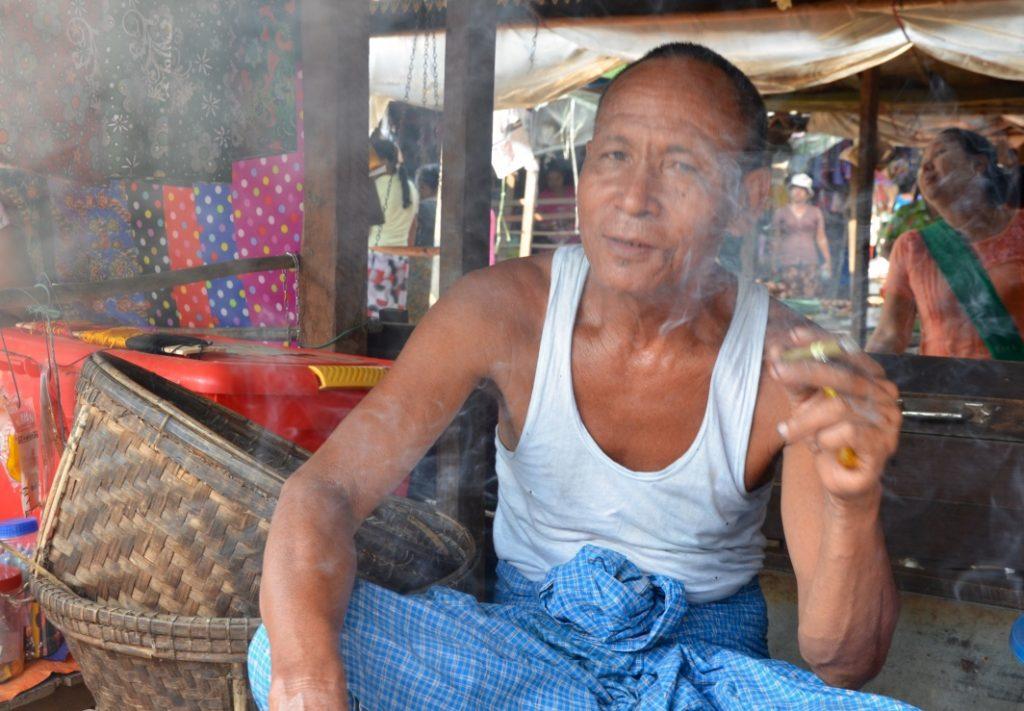 Male vendor Dala Island Myanmar