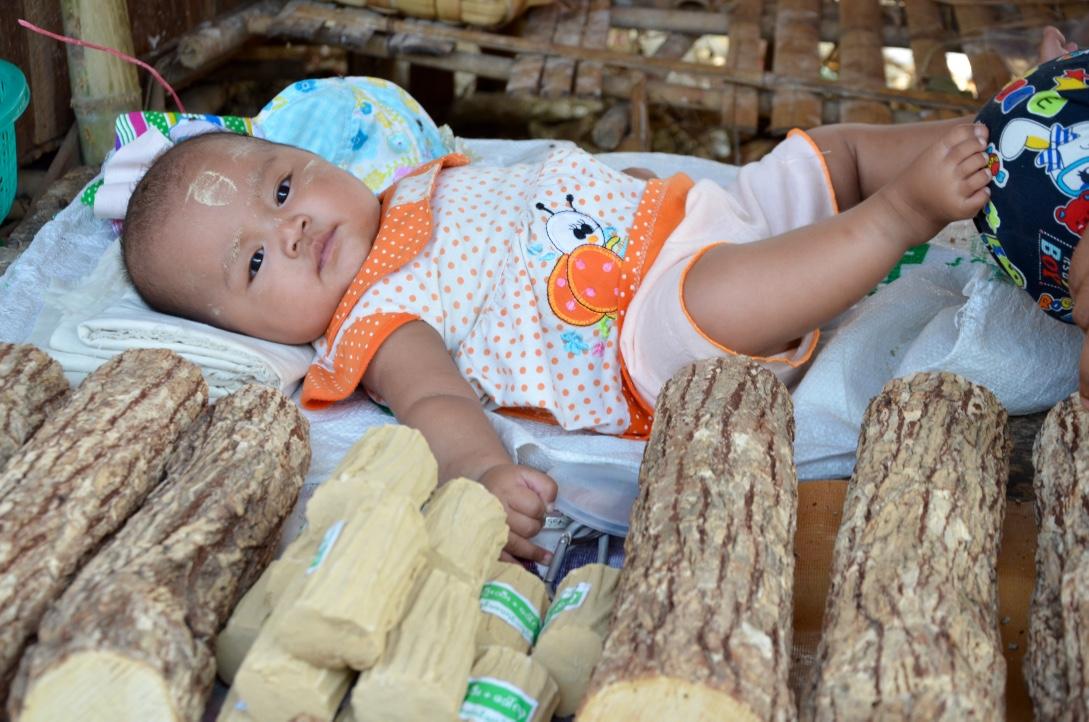Baby in Thanaka Market Dala Island Myanmar