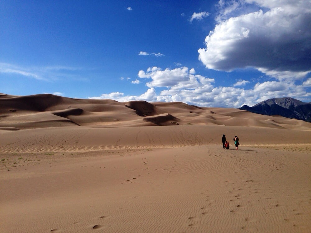 Hiking across the dunes at Great Sand Dunes National Park and Preserve